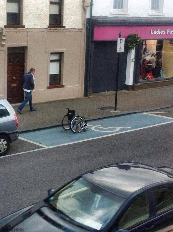 fauteuil-roulant-place-handicapee