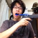 miniature pour Se brosser les dents avec un pistolet à air automatique