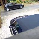 miniature pour Accident avec une moto en sortant la voiture du garage