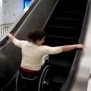 descendre-escalator-chaise-roulante